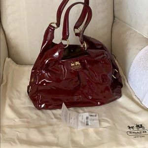 Slightly used patent leather coach purse